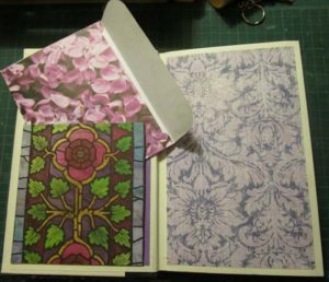 Peacock book inside cover with pocket and envelope.