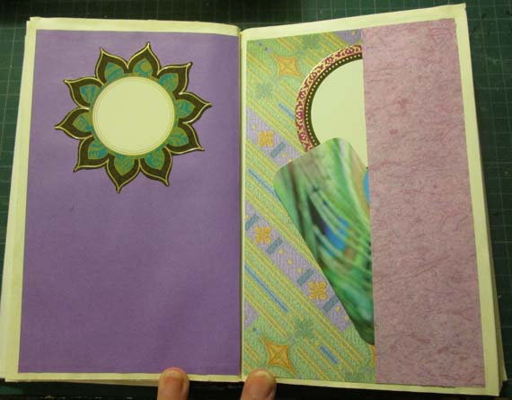 Peacock book pages with tuck space and tags on right.